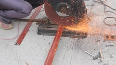 Worker use grinder to cut the steel bar Stock Footage