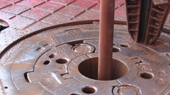 Slip on the rotary table while drilling oil well and pipe being rotated Stock Footage
