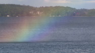 Stock Video Footage of Misty rainbow over lake on hot summer day