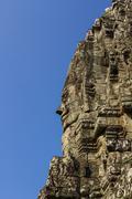 The bayon face, temple of angkor thom Stock Photos