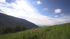 Mountain meadow with beautiful sun and sky Stock Footage