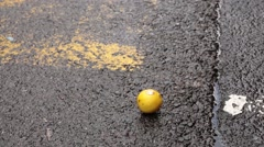Man finds a lemon on ground at market Stock Footage
