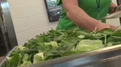 school cafeteria setup salad selections CU - stock footage