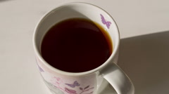 Pouring Sugar On Tea Cup - stock footage