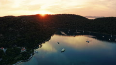 Sunset panorama at village Polace on island Mljet, aerial Stock Footage