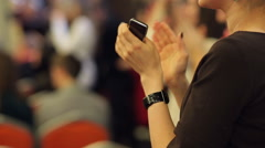 Girl with a Smartphone Applauds - stock footage