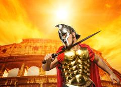 Roman legionary soldier in front of coliseum Stock Photos