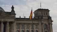 Flag on Reichstag at cloudy dark day, Berlin Stock Footage