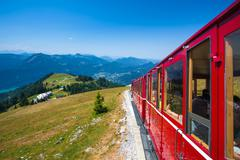 steam locomotive of a vintage cogwheel railway going to schafberg peak - stock photo