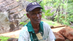 Local man working in Sigiriya, an ancient palace in Sri Lanka. Stock Footage