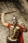 Roman legionary soldier in front of abstract wall . Stock Photos