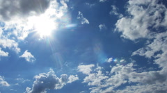 beautiful clouds with sun background - timelapse - stock footage