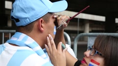 Argentina Fan was painting by an artist in 2014 World Cup Stock Footage
