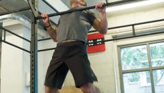 Chest to Bar Body Weight Movement at a CrossFit Box Stock Footage