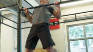 Stock Video Footage of Chest to Bar Body Weight Movement at a CrossFit Box