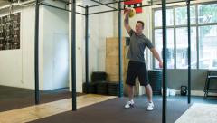 Trainer Executing Kettlebell Clean and Jerk Olympic Weightlifting Movement Stock Footage