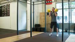 Double Kettlebell Push Press Weightlifting Movement at a CrossFit Box Stock Footage