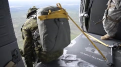 173rd Airborne Brigade UH-60 helicopter parachute Jump Stock Footage