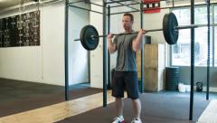 Crossfit Trainer Performing Heavy Cleans in a Certified Box Stock Footage