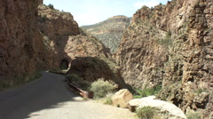 a shot of a car driving down nm highway 485 through a tunnel in jemez mountain - stock footage
