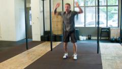 Crossfit Trainer performing Burpees in a certified box Stock Footage