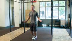 Double Unders Skip Rope Movement at a CrossFit Box Stock Footage