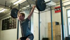 Overhead Squat Olympic Weightlifting Movement at a CrossFit Box Stock Footage