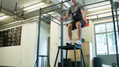 Box Jumps Body Weight as Camera Dollies Right Stock Footage