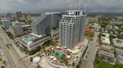 Aerial Hilton Hotel wind generators Stock Footage