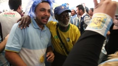 Argentina Fan Takes Photos with a Typical Brazilian in 2014 World Cup Stock Footage