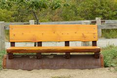 Cedar wooden park bench on the beach Kuvituskuvat