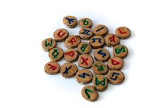 Carved and painted wooden oak runes on white Stock Photos