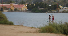 Couple Stand up paddleboarding Stock Footage