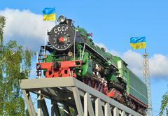 old locomotive on a pedestal - stock photo