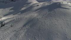 1080HD Cineflex racing along snowfields Stock Footage
