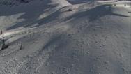 Stock Video Footage of 1080HD Cineflex racing along snowfields