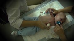 Doctor makes ultrasound to infant month-old baby Stock Footage