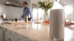 Milk bottle on a counter - stock footage
