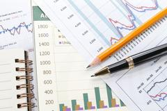 financial data concept with pen - stock photo