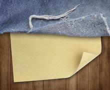 Stock Photo of brown wood texture with paper and jeans