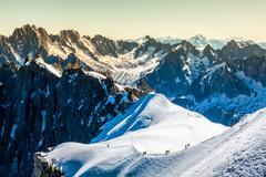 mont blanc, chamonix, french alps. france. - tourists climbing up the mountai - stock photo