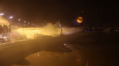 De-Icing an Airplane at the airport Stock Footage