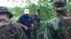 Navy Seal Type Instruction on Carrying Fins Stock Footage