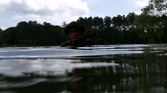 Water-Level View of Military Men in Camouflage Stock Footage
