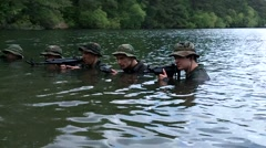 Waters Ripple Pass Military Trainees in Swamp Stock Footage