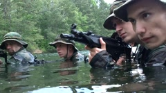 Men in Camoflage With Weapons in Swamp Stock Footage