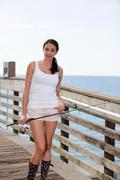 Beautiful woman with a fishing pole - stock photo