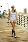 Woman walking on a fishing pier Stock Photos