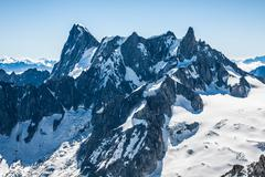 view of mont blanc mountain range from aiguille du midi in chamonix - landsca - stock photo