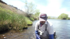 Releasing a brown trout in an Argentina river Stock Footage